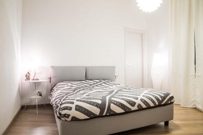 via-queirolo-camera-da-letto-appartamento-ristrutturato-pisa-Francesco-Martinelli